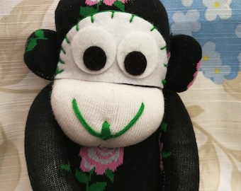 Black sock monkey with roses