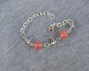 Swallow charm bracelet/pink