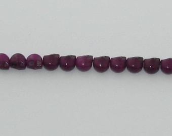 20 small beads skulls purple howlite
