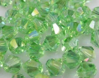 10 beads 6 mm Swarovski Crystal light peridot AB