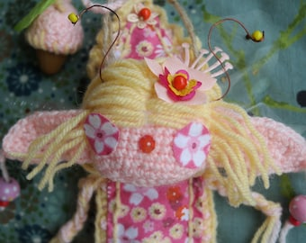 Doll art. Pink and yellow hibiscus Elf born on Wednesday, June 28, 2017 at 1:22