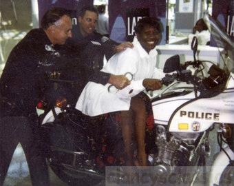 vintage photo 1967 Polaroid African American Woman Handcuffed by LAPD Motorcycle Police Color