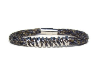 Woven variegated blue and brown hand dyed specialty yarn kumihimo bracelet with silver tone charm and stainless steel magnetic clasp