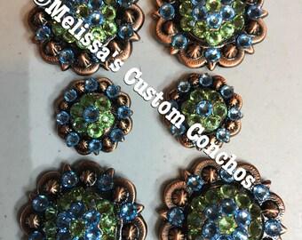 Copper concho saddle set with peridot and aquamarine