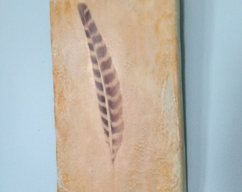 Feather. Encaustic photography. Carved feather wall hanging. Yellow, blue, orange. Natural decor.