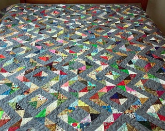 Gray queen-size quilt which will go with any decor.  All hand made, machine quilted
