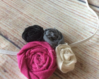 Adorble magenta, ivory, charcoal grey, and black rosette elastic headband