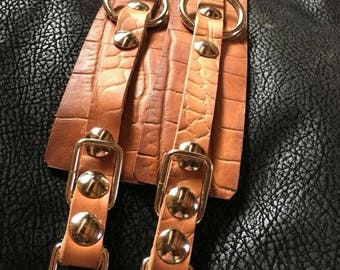 Embossed Gator print genuine leather cuffs, with a hand rubbed oil finish