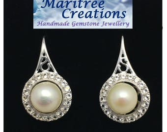 Freshwater pearl and 925 sterling silver earrings.