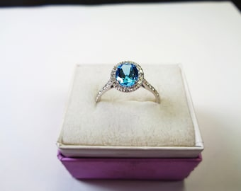 Dainty Natural Blue Topaz 14kt. Ring with Diamond Accents.