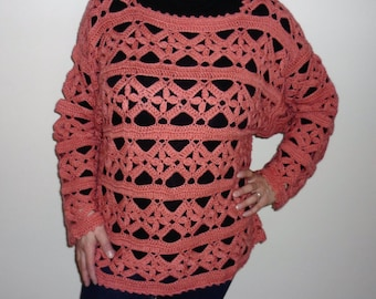 Pink colored crocheted sweater
