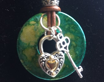 Green and yellow alcohol inked washer with silver heart lock and Key