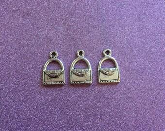 3 antique silvertone satchel charms