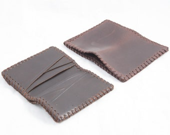 50. Small leather wallet with card
