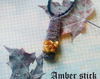 Nice artist   Amber stick  on leather string