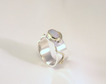 Silver ring with Moon stone in 14k gold setting