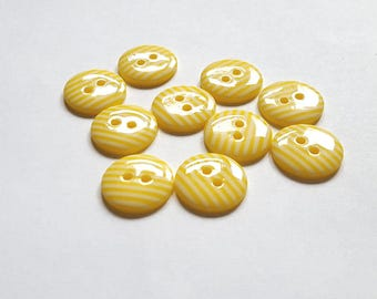 Yellow and white striped 2 hole buttons. 15mm. Pack of 10