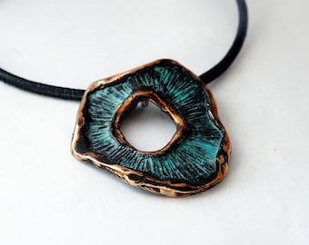 Bronze pendant with patina