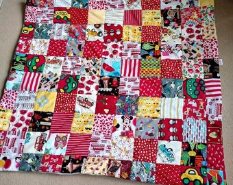 Gorgeous red themed hand made patchwork baby quilt or play mat
