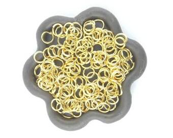 x 100 5mm (02E) Gold open jump ring
