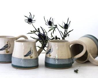 Large ceramic mug with seagull on a beach, bird mug, handmade green and cream mug, ceramic tea coffee mug, illustrated pottery