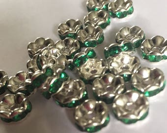 Set of 10 Grade A Dark Green rhinestone spacer beads. 7x3mm
