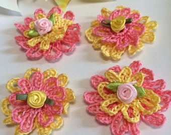 Crochet Salmon & Yellow Flowers...4crochet daisies with satin flower centers...