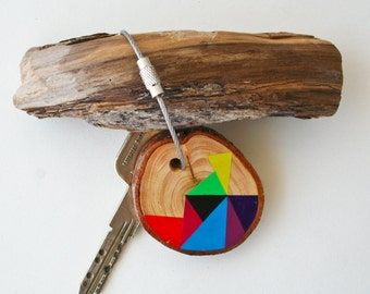 wood keychain with stainless steel cable wire plus custom initial, tones of yellow, blue, red, orange, black geometric triangle  keyring