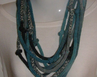 Multi row necklace with green nodes