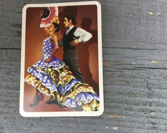 Vintage playing cards with Spanish flamenco dancers on the reverse side