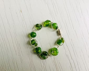 Green wirework bracelet of silver wire and glass beads