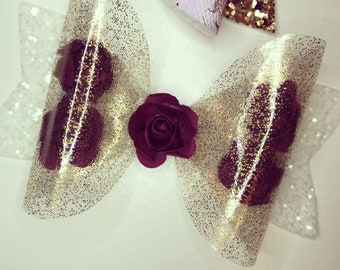 Clear gold glitter bow with roses