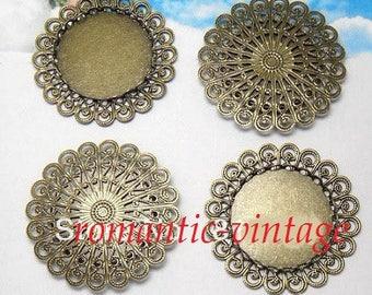 2 pretty medium bronze cabochons 25mm on filigree engraving