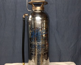 Pyrene fire extinguisher toilet paper holder