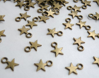 50 Tiny star charms antique bronze 11x8mm DB23147