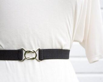 Skinny black elastic waist belt with interlocking clasp
