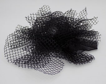 Black netting and rhinestone silver hair clip