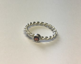 Silver Ring corded with garnet