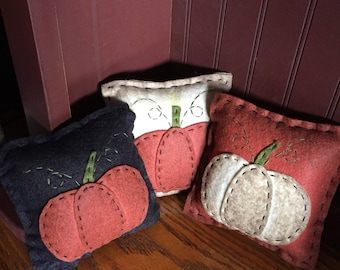 Set of 3 bowl filler pillows black, white and orange with pumpkins on them.