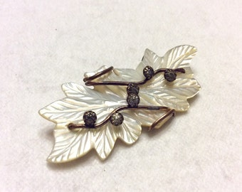 Antique mother of pearl brass wire and rhinestones flower brooch pin.