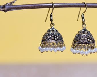 Oxidised gold metal jhumki with white glass pearl beads