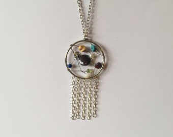 Dreamcatcher pendant necklace, multi-colored stones in the web.  Leather and chain