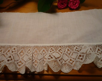 White lace on white cotton fabric