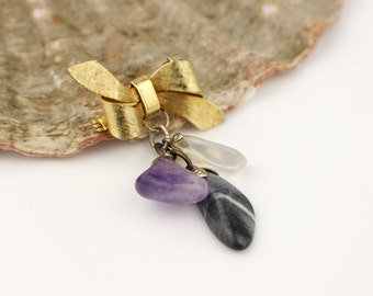 1970s Gold Tone Bow Brooch  With Amethyst Clear and Grey Quartz Stones