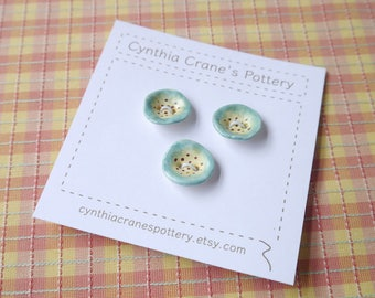 Small Blue Hollyhock Buttons, Ceramic Porcelain Clay, Blue and Yellow with Brown Highlights