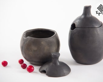 Black pottery bowl with a lid