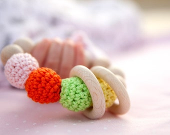 Soft and sweet candy toy. Teething ring toy with crochet wooden beads. Rattle for baby.