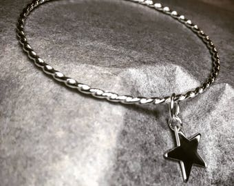 Twisted silver star bangle