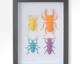 Four beetles. Realistic 3-D paper implementation of insects