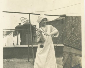 vintage photo 1913 Young Woman Apron Cap Beating Rug w Rugbeater on Roof NYC